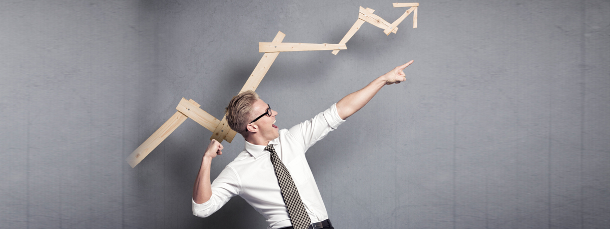 man pointing up in direction of an arrow