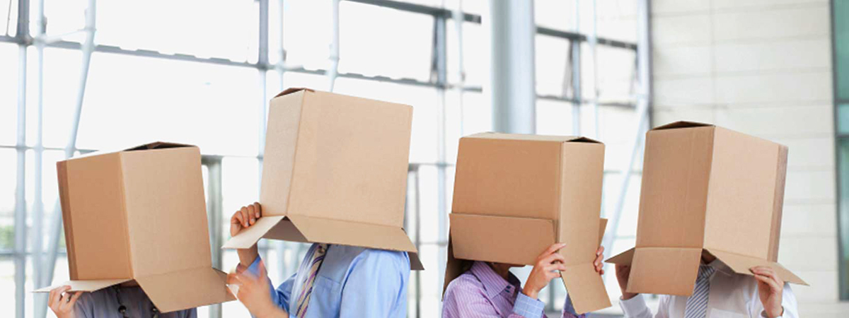 4 people with boxes over their heads
